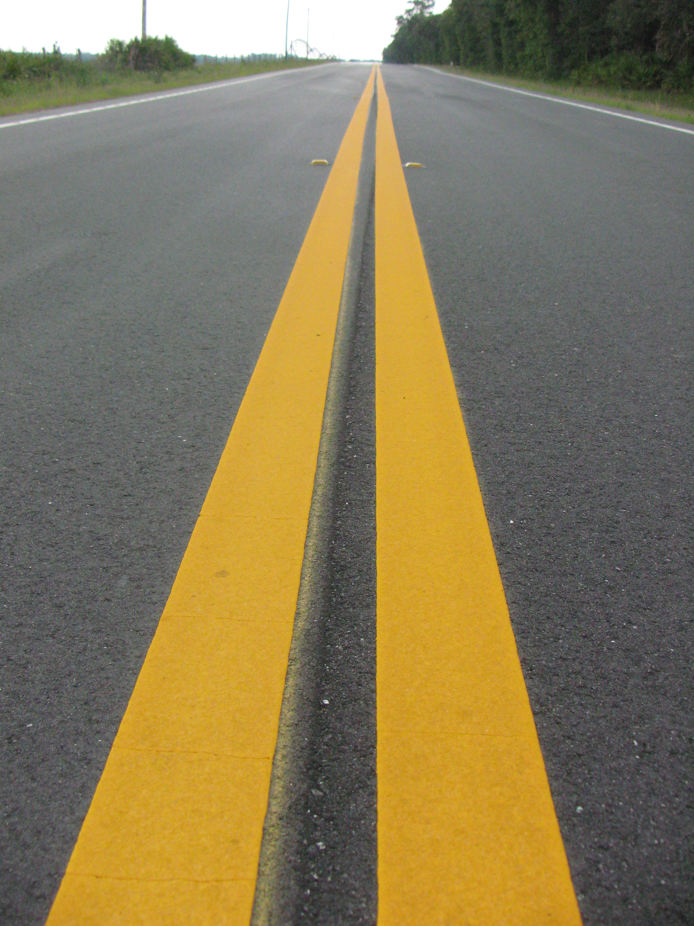 Photo of yellow stripes in road.